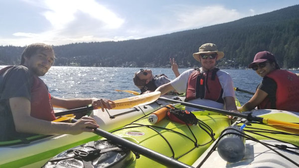 Vizzion's team enjoys some time on the water after work
